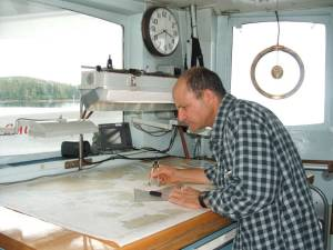 Here I am studying nautical charts as preparation for the Tidal Gauge expedition.
