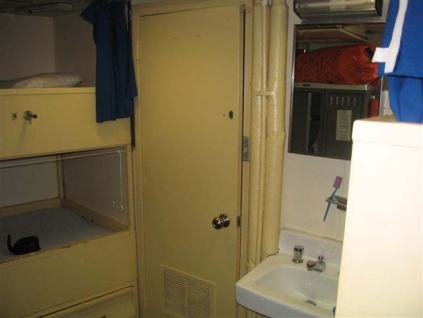 Our four bunk room.  Debbie Durate on the night shift and Jacquie Ostrom and I on the day shift shared this room.  It was understood we were not to return to the room any time during our 12 hour shift. The shower is behind the sink and not much wider.