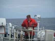 Jim Pontz, a fisherman, working the A-frame.