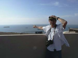 From the top of El Morro, NOAA Teacher at Sea, Dave Grant, points to the Ron Brown anchored offshore.