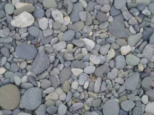 The beach at Inner Iliasik Island is made of pebbles instead of sand