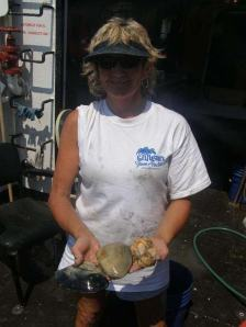 Lisha holding sea specimens retrieved from clam dredge