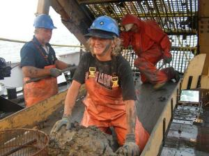 Lisha, Mark Harris and Richard Raynes in the clam dredge towing out the remains of the mud sediment.