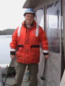 NOAA Teacher at Sea, Matt Lawson, in a Positive Floatation Device and hard hat.