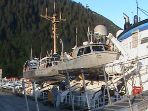 Three of RAINIER's launches hang in their davits.