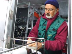 NOAA Teacher at Sea, Gary Ledbetter, helps prepare the CTD for a cast.