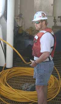 Chief scientist Andrew David feeds out the ROV's umbilical during deployment.