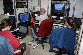 The ship's dry lab serves as a control room for the ROV. From left to right: Marta Ribera (GIS specialist), ROV pilot Lance Horn, and Stacey Harter (fish biologist).