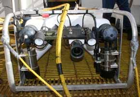 This remotely operated vehicle (ROV) carries both a video camera and a still camera.  The yellow umbilical shown in the foreground supplies power and control signals from the GORDON GUNTER.