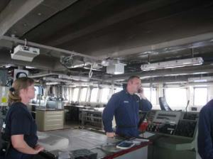 CDR Anne Lynch and ENS Kyle Sanders on the bridge of the Bigelow