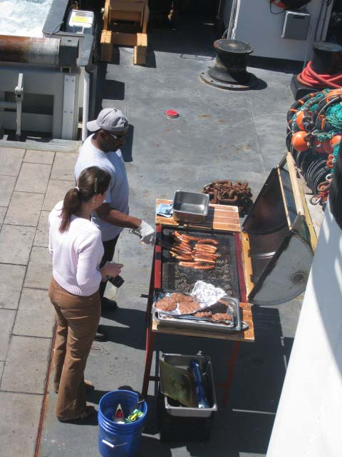 Grilling on the back of the ship.  One of the crew made the grill from an old barrel and installed the handle and the base.