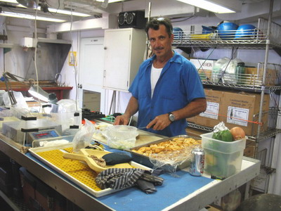 Joao preparing his secret calamari marinade.