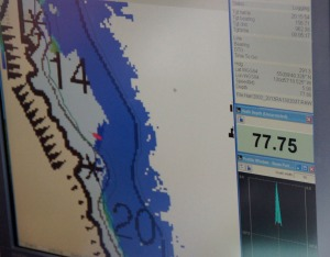 One of the screens on the plotting computer indicates the areas that have been surveyed (in blue) and where the ship is.