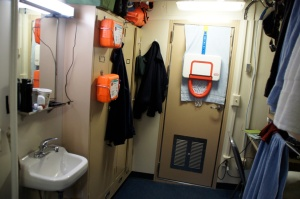 A cozy state room at sea - looking toward the door.