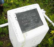 Grave marker of Karl Mueller.  The Fairweather crew maintains the grave and established a benchmark on the marker.