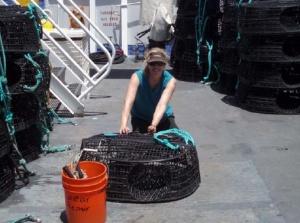 NOAA Teacher at Sea, Maggie Flanagan, repairs a trap aboard NOAA Ship OSCAR ELTON SETTE.