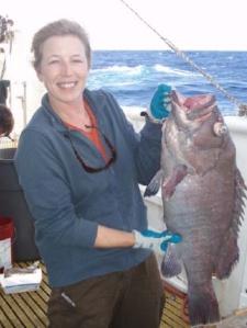 Teacher at Sea Maggie Flanagan with a 71.2cm hapu`upu`u (Epinephelus quernus)