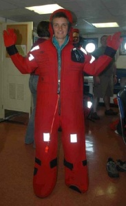 """NOAA Teacher at Sea Elizabeth Eubanks models the abandon ship suit, also known as a """"Gumby"""" suit."""