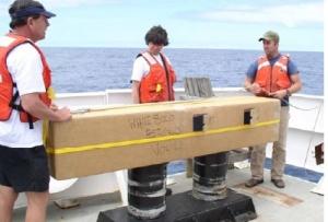 Crew holding the Argos drifter