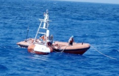 Preparing to haul in a buoy