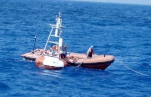 Preparing to haul in a buoy