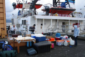 Loading gear onto the McARTHUR II in the snow and rain