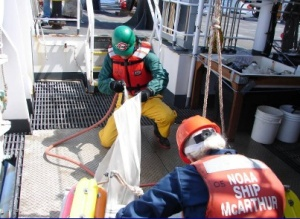 NOAA TAS Scott Donnelly (green helmet) and fellow science team member Bob Sleeth collecting zooplankton