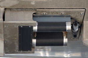The multibeam sonar units on the bottom of the launch.