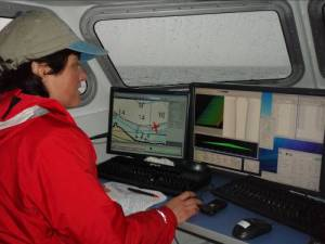 NOAA Teacher at Sea, Terry Welch, assists in a hydrographic survey aboard the launch.