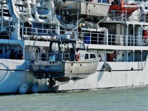 Rainier lowering a launch vessel