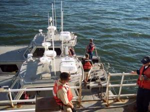 Crew members prepare the launches to collect data using side-scan and multi-beam sonar