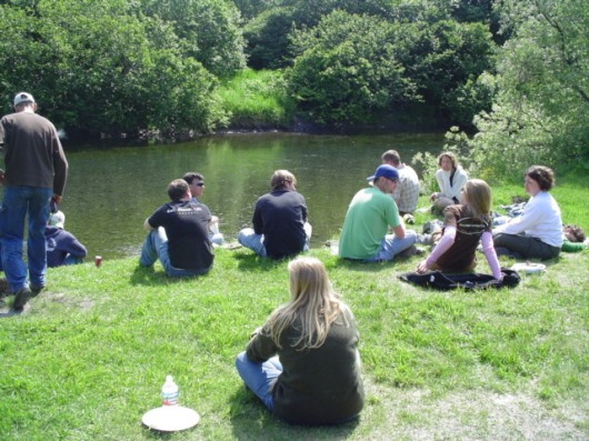The crews of the FAIRWEATHER and RANIER relax at a Fourth of July picnic.