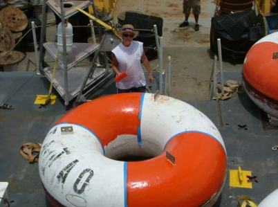 TAS Braun paints one of the TAO buoys to ready it for deployment.
