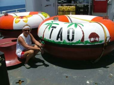 TAS Braun displays her creative buoy artwork.