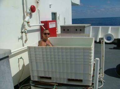 "TAS Braun relaxes in the KA'IMIMOANA's ""pool."""