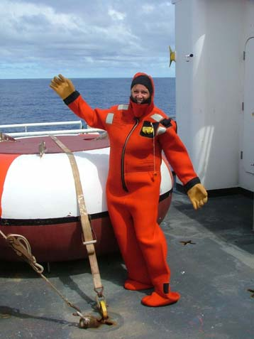 "NOAA Teacher at Sea, Karolyn Braun, tries on her ""gumby suit."""