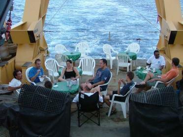 Enjoying dinner on the fantail of the ship