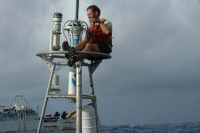 Chief Scientist, Patrick A'Hearn replaces a rain gauge and sea surface salinity sensor on a TAO buoy.
