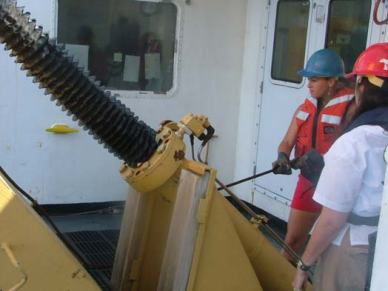 TAS Braun helps to cast the CTD off the deck of the KA'IMIMOANA.