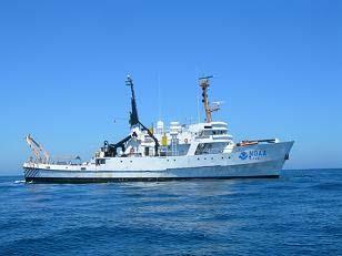 The DAVID STARR JORDAN awaits the return of its Zodiac boat.