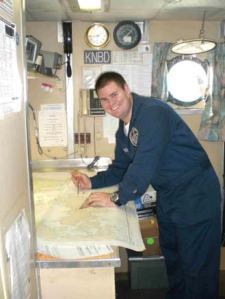 Navigation Officer Mark Frydrych charting the route the ship will take.