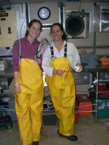TAS Jill Carpenter and Fisheries Biologist Karen Bolles with a subsample of herring collected from a midwater trawl.