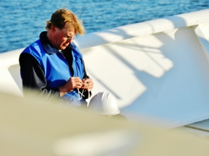 Chief Boatswain Jim Kruger practicing knots