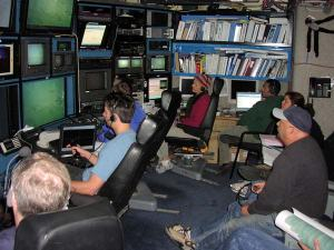 The science crew in the Control Room of the WESTERN FLYER as we watch video from the Tiburon.