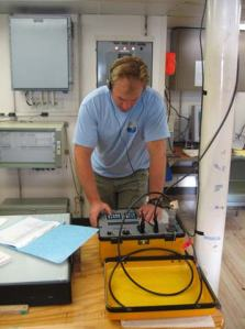 Buoy Technician, Sean Whelan, contacting the Acoustic Releases on WHOTS-2.