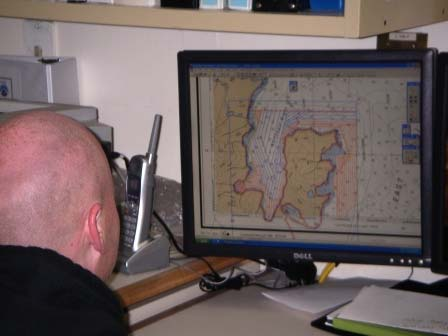 Shawn Gendron, Hydrographic Assistant Survey Technician, processing survey line data