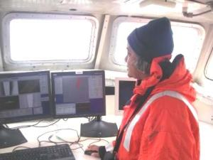 TAS Jacquelyn Hams viewing sonar images on a survey boat