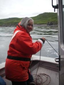 TAS Jacquelyn Hams uses a lead line to determine depth during a shoreline survey