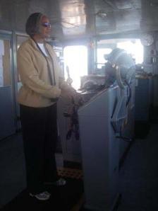 TAS Jacquelyn Hams at the helm of the NOAA Ship RAINIER