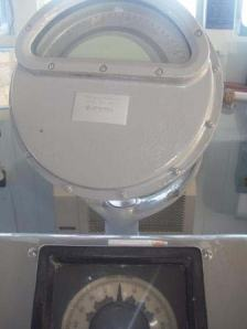 Gyrocompass repeater (top) and rudder angle order indicator (bottom)